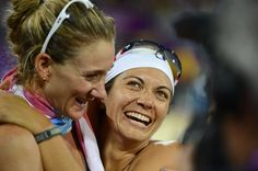Misty May-Treanor and Kerri Walsh (left) embrace after winning the gold medal after defeating April Ross and Jennifer Kessy (USA) in the women's beach volleyball gold medal match