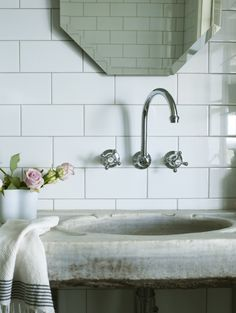 slab sink and wall mounted faucet.  byron view farm cottage bathroom.