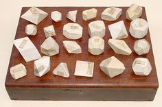 Collection of 24 cream colored biscuit porcelain crystal models.