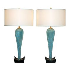Pair of Seguso Turquoise and Gold Murano Lamps on Black Lacquer  Italy  1950's  These turquoise/aqua Murano lamps with swirls of copper are spectacular! The Asian-style bases, which were original to the pair, have been relacquered in an ebony egg shell finish.