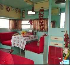 Awesome green  red interior of vintage camper. Super cute. :-)