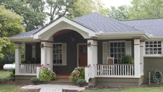 Add on a porch.  What a difference! http://porchco.com/wp-content/uploads/2013/05/Gable-Hip.jpg