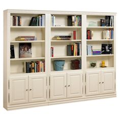 Set of three bookcases with cabinets and open shelves.Product: 3 Piece bookcase set  Construction Material: Solid oak ...