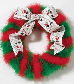 Maybe change the ribbon...Hang a fun fluffy boa wreath on your door to bring on the holiday spirit! #fabulouslyfestive