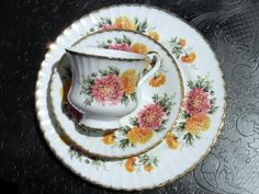 """Paragon Chrysanthemums English Bone China Trio - High Handled Teacup Saucer and Side Plate Named from the Greek prefix """"chrys-"""" meaning golden"""