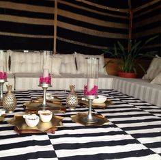 Those of you who guessed an ecru-ified tent is correct! We used our black/white dhurries and brass accessories as well as our flute candlestick holders. Marble pineapples for snacks too. We chose a subtle striped linen to cover the seating and complimented it with our tonal palm pillows. A little bit of modernity in tradition for this winter. #ecru #tent #winter #baitsha3ar #home #decor #accessories #interiors #brass #glass #cotton #marble #candlestick