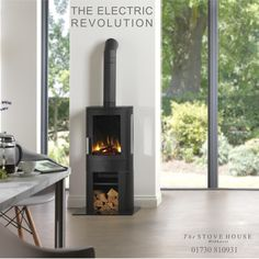 Take a look at the NEO contemporary electric stove with log - 2 kw heat settings. Electric Log Burner, Electric Wood Stove, Electric Stove Fireplace, Electric Fires, Log Effect Electric Fire, Log Store, Stove Oven, Pellet Stove, Kitchen Stove