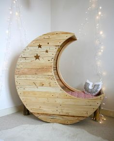 moon crib.  Made by French carpenter Jocelyn Costis and designed by his wife Emilie Perez (Crème Anglaise) for their new baby