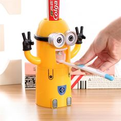 Minions Automatic Toothpaste Dispenser.Totally hands-free, clean and tidy.The upside down cup dry fast and dust free.Magnet inside help back to the original place.Can hold two toothbrush.Comes with a attached adhesive pad for easy installation.