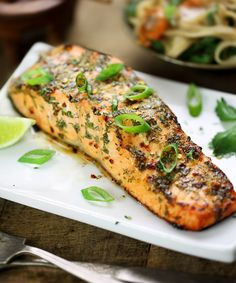 Succulent salmon infused with a ginger, lime, chili and cilantro dressing, and baked until deliciously moist and tender. Fish Recipes, Soup Recipes, Cooking Recipes, Thai Cooking, Smoked Salmon Recipes, Thai Recipes, Healthy Cooking, Seafood Recipes, Paleo Recipes