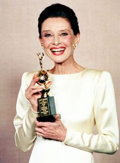 A grinning Audrey Hepburn poses with her Cecil B. Demille award at The 47th Annual Golden Globe Awards held at the Beverly Hilton Hotel, Beverly Hills, California, January 20, 1990.