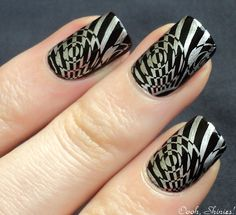 Black and silver hypnotic nails