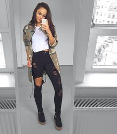 Camo shirt over white tee and black jeans.