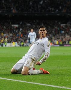 Cristiano Ronaldo of Real Madrid CF celebrates after scoring his team's second goal during the La Liga match between Real Madrid CF and Real Sporting de Gijon at Estadio Santiago Bernabeu on April 2012 in Madrid, Spain. Cristiano Ronaldo 7, Cr7 Ronaldo, Ronaldo Real Madrid, Good Soccer Players, Football Players, Football Icon, Football Quotes, Look Adidas, Chelsea