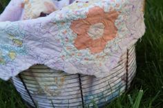 """I am absolutely in love with this gorgeous piece of history. This quilt is hand stitched and amazing!  You will receive an approximate 20"""" X 20"""" piece that can be used as a basket stuffer or layering piece!  Please note that this is a grab bag and no two pieces will be identical.  Be assured that they are all from the same gorgeous quilt though.  Some edges may be finished and scalloped, others will not be.  All will be treasured for sure! LAYERING PIECE measures appro..."""