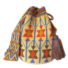 These double thread Wayuu mochila bags are all made in the region of La Guajira, Colombia by indigenous Wayuu women. Mochila bags are a very important handicraft that helps sustain the indigenous Wayuu people. These bags take approximately 10 days to make. The craft of crocheting is learnt at an early age and passed down from generation to generation. The mochilas are a reflection of the everyday shapes that surround the lives of the Wayuu tribe. Buy yours at www.lombiaandco.com