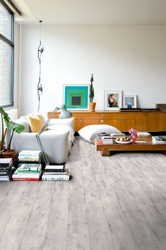Quick-Step Laminaatvloer - Impressive Ultra 'Lichtgrijs beton' (IMU1861) in een trendy woonkamer. Vind hier jouw favoriete woonkamervloer. #laminaat #vloer #inspiratie #woonkamer