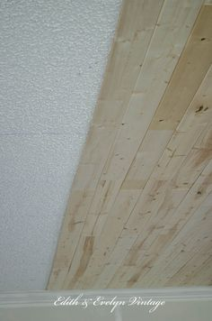 plank a popcorn ceiling with lightweight tongue and groove wood planks.