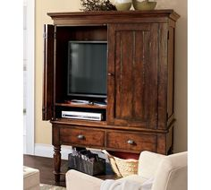 armoire to hide the tv, DVD player, cable box, etc. - color adds to the feeling of warmth in the room and hides the clutter