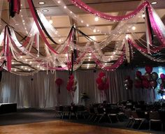 One of my all time favorite looks.....dance floor tulling, ribbons and lights and the walls draped with uplights. How beautiful.