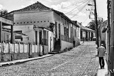 Timeless From Cuba Classic Black and White Collection from Photographic Art by Dawn. In once-prosperous Trinidad, time stands still. The signs of its former splendor are evident in the colorful Colonial architecture and in the local and European luxuries on display in museums on the main square. The tourist trade is a blessing and a priority for government investment in the town. The buildings and people provide a bounty of photographic opportunities for amateur and professional alike. #Cuba