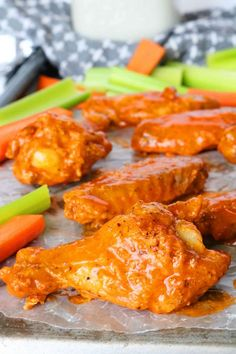 You can make crispy buffalo wings at home no problem! With a foolproof easy homemade buffalo sauce recipe chicken wings baked in the oven and a a stellar blue cheese dip you'll be all set for a party food win! Baked Chicken Wings, Chicken Wing Recipes, Recipe Chicken, Thai Chicken, Chicken Tenders, Keto Chicken, Spicy Recipes, Great Recipes, Dinner Recipes