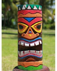 I've always loved totem poles and I am so getting one in the garden when I have my own place. Also loving tikis!.Solid Wooden colourful Wiki Tiki Totem Pole | 25cm