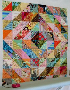 I love these triangle quilts....but in more traditional prints - or quilts of valor colors.  fromhttp://sewkatiedid.wordpress.com/2009/03/20/value-quilts-tutorial/#