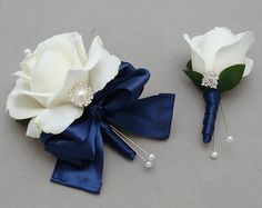 White and navy wrist corsage. Love the bow!