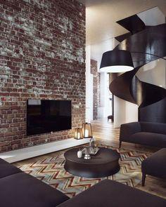 Die Klinker Wand wirkt wie ein Akzent im Wohnzimmer