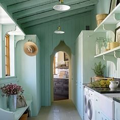 love this country laundry room. Decorate with Blue | Use Blue In a Small Space | SouthernLiving.com