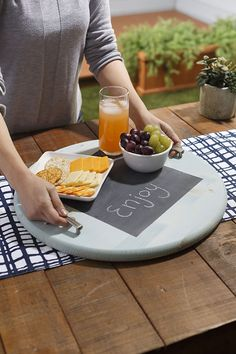 DIY Party Tray with a Message-- wouldn't this be fun to use while entertaining? Write a greeting to your guests, label what's on the tray, or draw a holiday doodle! All it takes is some chalkboard paint, wood and paint. We have the instructions at The Home Depot Blog.