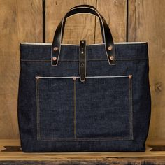 Now available at Anthem Store in Shoreditch, London.  Denim Tote Bag with Black Leather Handles