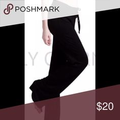 Black yoga pants Cotton spandex blend , very stretchy and comfortable. Elastic and drawstring waist. Direct from distributor without store tags. Waist  30 inches unstretched and 31 inch inseam Pants