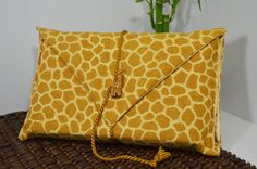 Book Cover, Book Protector, Paperback/Hardback Book Cover in Giraffe Print Flannel, Giraffe Button and Twist Cord-Great Gift for Book Lovers. $19.95, via Etsy.