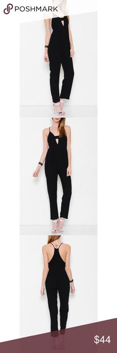 """""""Right Now"""" Deep V Black Jumpsuit PRICE FIRM UNLESS BUNDLED  Strappy jumpsuit with a deep v drop. Brand new without tags. Junior sizing. NO TRADES. Bare Anthology Dresses"""