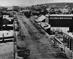 Looking south along Spring St., Bunker Hill to the right. 1876(?)