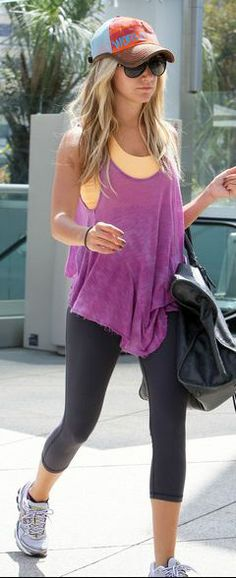 Who made Ashley Tisdale's black handbag, hat, purple tank top and sneakers that she wore in West Hollywood?