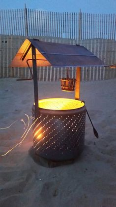 Build a wishing well burn barrel from an old washing machine drum – DIY projects for everyone! Burn Barrel, Barrel Fire Pit, Metal Barrel, Diy Fire Pit, Fire Pit Backyard, Fire Pits, Outdoor Projects, Diy Projects, Outdoor Decor