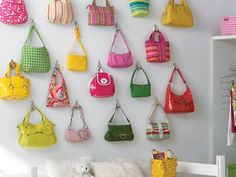 If you can't bear the thought of not bringing your ever-growing purse collection to college, use stick-on hooks from the Container Store to hang them right on your dorm room wall!