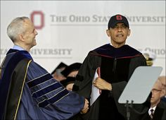 David Horn congratulates President Obama after he accepts an honorary doctor of laws degree at Ohio State's graduation ceremony at Ohio Stadium. Mr. Obama is the third sitting president to give Ohio State's commencement address, following George W. Bush in 2002 and Gerald Ford in 1974. ASSOCIATED PRESS