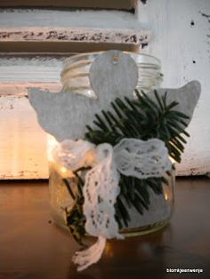 glass jars and little wooden angel
