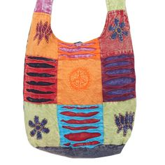 Patchwork Jogi Bag with Peace Design houses book, light clothes, and water bottle. Available in 4 different colors, the bag features razor cuts, Velcro mobile pocket, appliqués, broad shoulder strap, inside pocket, main zippered compartment, and button closure.