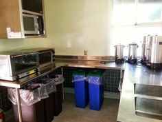 Kitchen/prep area.  Large table-top convection/toaster oven, microwave, sink, and coffee makers.