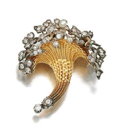 GOLD, SEED PEARL AND DIAMOND BROOCH/ PENDANT, LATE 19TH CENTURY.  Designed as a cornucopia, set with a seed pearl, circular-, single-cut and rose diamonds, detachable brooch fitting.