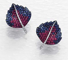 CARNET A Pair of Ruby and Blue Sapphire Earrings Each of foliate design, entirely decorated with pave-set rubies and sapphires, centrally enhanced with pave-set diamonds, mounted in oxidized platinum, cm. Lotus Jewelry, Ruby Jewelry, Sapphire Jewelry, Sapphire Earrings, Stone Earrings, Fine Jewelry, Unique Jewelry, Titanium Jewelry, Colored Diamonds