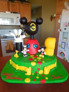 This is the Mickey Mouse Clubhouse cake that I made for my son's 3rd Birthday.  The bottom is Devils food cake with peanut butter cup buttercream.  The clubhouse is funfetti cake with strawberry cream cheese filling.  The shoe garage is rice krispie treats. The Head and glove are fondant covered styrofoam.  The entire cake is covered with homemade marshmallow fondant.