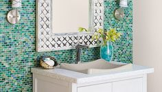 """I love the tile and sconces. I would prefer a darker wood and a natural element sink though. Kind of a Hawaiian feel, maybe for a cabana bath.  """"Small Bath, Big Impact"""" from Lowe's Creative Ideas"""