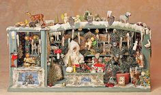 """ANTIQUE DOLL HOUSE CHRISTMAS STORE ROOM BOX FROM GERMANY, WITH MUSICAL MOVEMENT. 22"""" W. x 11"""" H. x 9 ½"""" D."""