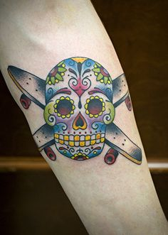 Tattoo of Crossed Skate Decks and Sugar Skull by Chris Hold